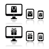 Shopping online, internet shop icons set. Vector icons set - shopping bag and present on electronic devices Stock Photography