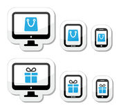 Shopping online, internet shop icons set. Vector labels set - shopping bag and present on electronic devices Stock Image