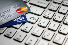 Shopping online just one enter button with credit cards royalty free stock photos