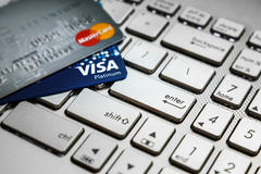 Shopping online just one enter button with credit cards stock images