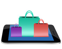 Shopping online through the mobile phone Royalty Free Stock Photo