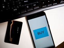 Shopping online with phone and credit card royalty free stock photography