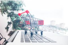 Shopping online with shopping cart and credit card concept Stock Photos