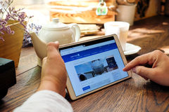 Shopping online on United airlines website. Stock Image