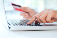 Shopping online use credit card to pay online. Stock Photos