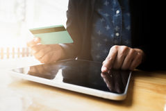 Shopping online use credit card to pay online. Stock Photography