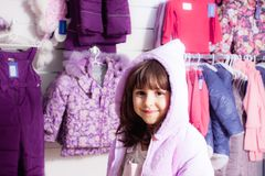 Shopping at outerwear supermarket Stock Images