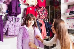 Shopping at outerwear supermarket Royalty Free Stock Images
