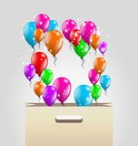 Shopping paper bag and balloons Stock Photography