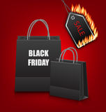 Shopping Paper Bags for Black Friday Sales and Discount with Fire Stock Images