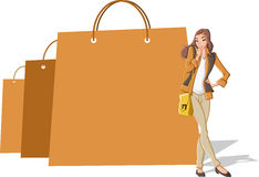 Shopping paper bags and pretty teenager woman Stock Images