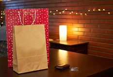 Shopping paper bags on a table stock photo