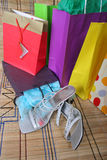 Shopping parcels with shoes. Shopping parcels and womans shoes lying on the ground after spending spree royalty free stock photography