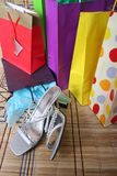Shopping parcels with shoes. Shopping parcels and women shoes lying on the ground after spending spree Stock Photos