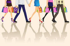 Shopping people. A vector illustration of shopping people carrying shopping bags Stock Photography