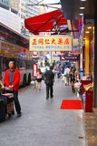 Shopping people and a bus stop in Nathan Road, Hong Kong Royalty Free Stock Images