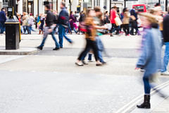 Shopping people in the city. Shopping people in motion blur at the Oxford Circus in London City, crossing the street Royalty Free Stock Photos