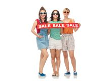 Happy female friends with sale banner Royalty Free Stock Images