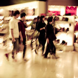 Shopping people crowd abstract background. City shopping people crowd at marketplace shoe shop abstract background Stock Photos