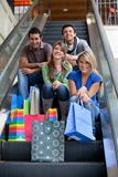 Shopping people on escalators Stock Images