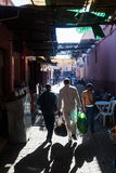 Shopping people in the famous souks of Marrakesh Royalty Free Stock Photography