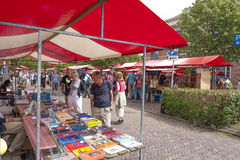 Shopping people at market stalls of historic book fair. DEVENTER, THE NETHERLANDS - AUGUST 3, 2014. Market stalls of famous and historic book fair with shopping Royalty Free Stock Images