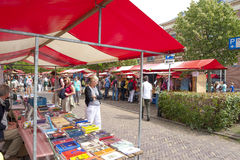 Shopping people at market stalls of vintage book fair Royalty Free Stock Image