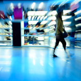 Shopping people at marketplace shoe shop. City shopping people crowd at marketplace shoe shop abstract background Royalty Free Stock Images
