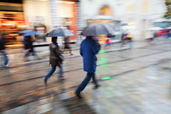 Shopping people in the rainy city Royalty Free Stock Photography
