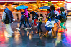 Shopping people in the rainy city at night Royalty Free Stock Photos