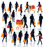 Shopping people. Set of people silhouettes. Happy shopping people holding bags with products. EPS 10 Royalty Free Stock Photo
