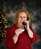 Shopping by phone. A grandma ordering holiday gifts over phone Royalty Free Stock Photo
