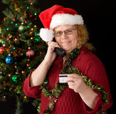 Shopping by phone. A grandma ordering holiday gifts over phone Royalty Free Stock Image