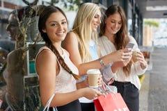 Shopping phone girl portrait Stock Photography