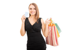 Shopping. Portrait of a beautiful young woman shopping isolated on white background Royalty Free Stock Photo