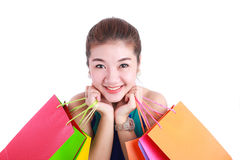 Shopping.Portrait of young happy smiling woman with shopping bags Royalty Free Stock Images