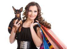 Shopping posh girl with miniature pinscher Stock Photo
