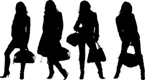 Shopping posing girls. Vectors silhouette Royalty Free Stock Photos