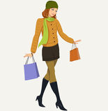 Shopping. Pretty teenage girl in a jacket with shopping Stock Photos