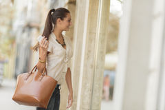 Shopping. Pretty young woman in shopping Royalty Free Stock Image