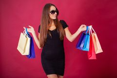 Free Shopping. Pretty Young Woman Stylishly Dressed In Black With Bags After Shopping Stock Photos - 144280033