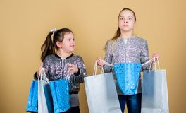 Shopping and purchase. Black friday. Sale and discount. Shopping day. Children hold bunch packages. Kids fashion. Expect royalty free stock photo