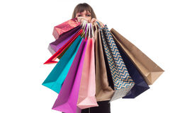 Shopping purchases, many colourful paper bags, packages in female hands. Close-up of shopping purchases, many colorful paper bags, packages in female hands royalty free stock photography