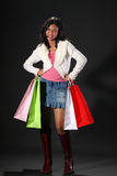 Shopping queen. Young woman with shopping bags stock images