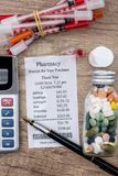 Shopping receipts with pills, calculator. On desk Stock Photo