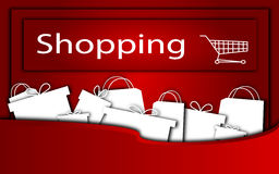 Shopping. Red background with presents and bags Stock Image