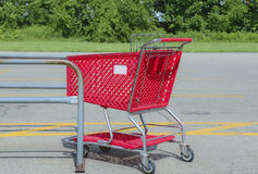 Shopping. Red shopping cart Royalty Free Stock Photography