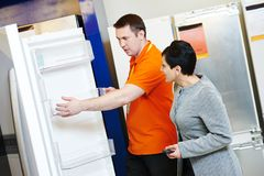Shopping refrigerator with assistant Royalty Free Stock Photo