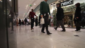 Shopping rush. People in shopping rush for Christmas presents in crowded mall in London stock video