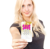 Shopping sale bargain card woman. Young woman is smiling while showing bargain Card Royalty Free Stock Images